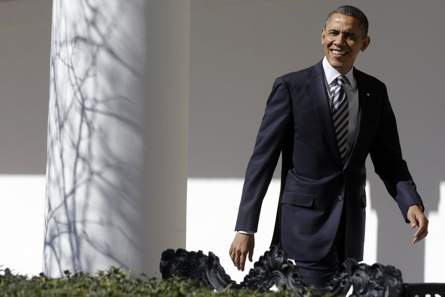 President Obama looks towards reporters shouting questions as he walks down the West Wing Colonnade of the White House in Washington on Feb. 12, 2013, ahead of the State of the Union speech on Capitol Hill that evening. (Associated Press)