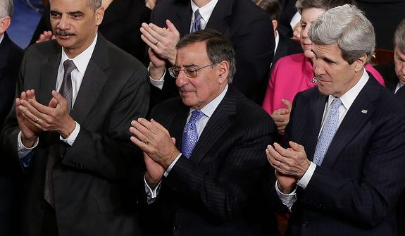 From left, Attorney General Eric Holder, outgoing Defense Secretary Leon Panetta and Secretary of State John Kerry applaud  during President Barack Obama's State of the Union address during a joint session of Congress on Capitol Hill in Washington, Tuesday Feb. 12, 2013. (AP Photo/J. Scott Applewhite)