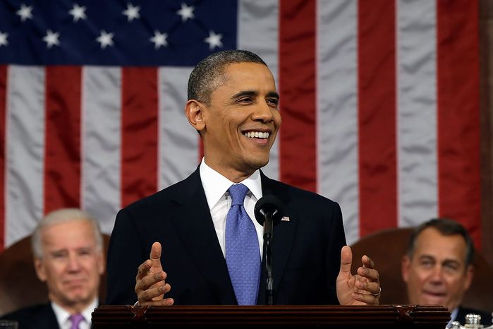 President Barack Obama, flanked by Vice President John Biden and House Speaker John Boehner smiles as he gives his State of the Union address during a joint session of Congress on Capitol Hill in Washington, Tuesday Feb. 12, 2013. (AP Photo/Charles Dharapak, Pool)