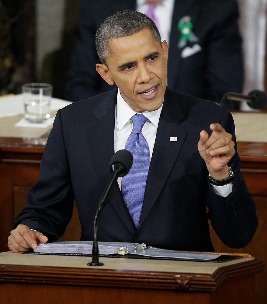 President Obama gestures while giving his State of the Union address during a joint session of Congress on Capitol Hill in Washington on Tuesday, Feb. 12, 2013. (AP Photo/Pablo Martinez Monsivais)