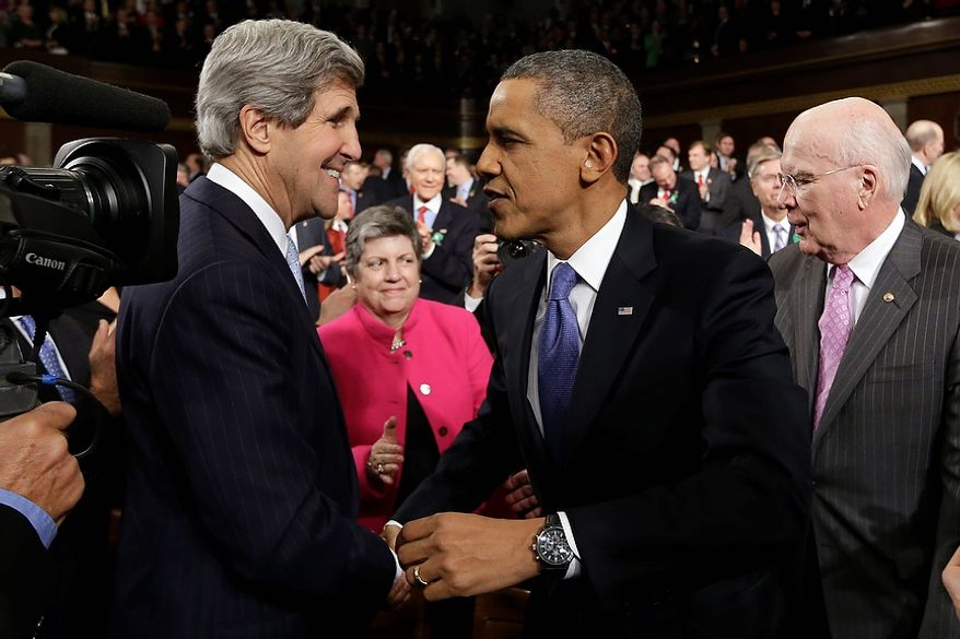 Secretary of State John Kerry greets President Barack Obama before the president's State of the Union address during a joint session of Congress on Capitol Hill in Washington, Tuesday Feb. 12, 2013. Sen.Patrick Leahy, D-Vt. is at right, Homeland Security Secretary Janet Napolitano is at center. (AP Photo/Charles Dharapak, Pool)