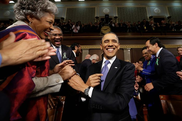 President Barack Obama is greeted before his State of the Union address during a joint session of Congress on Capitol Hill in Washington, Tuesday Feb. 12, 2013. (AP Photo/C