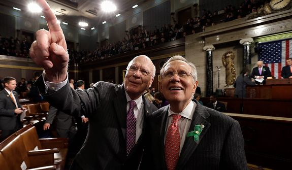 Sen. Patrick Leahy, D-Vt., left, and Senate Majority Leader Harry Reid of Nev. arrive on Capitol Hill in Washington, Tuesday, Feb. 12, 2013 for President Barack Obama's State of the Union address during a joint session of Congress on Capitol Hill in Washington. (AP Photo/Charles Dharapak, Pool)