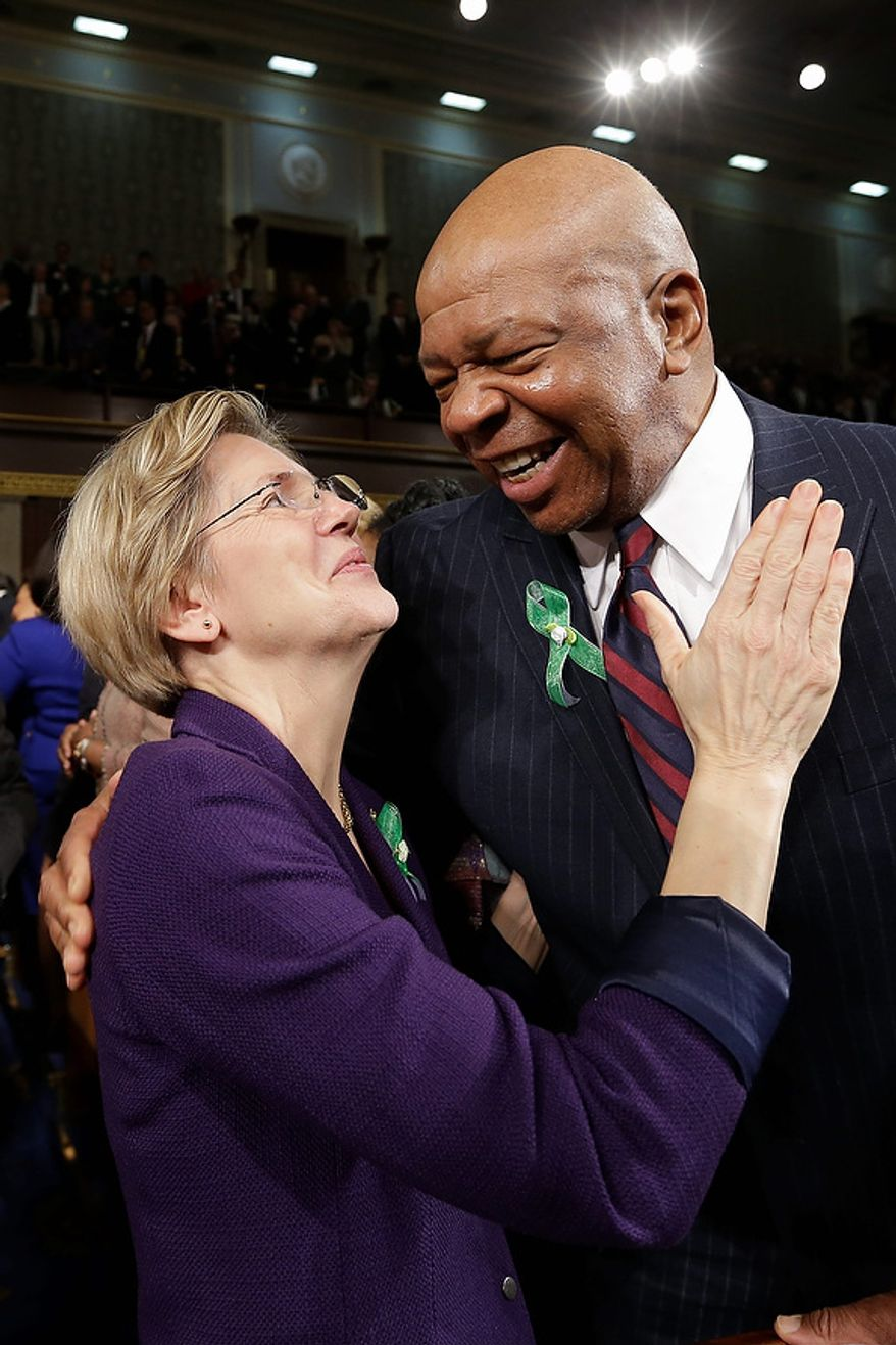 Sen. Elizabeth Warren, D-Mass., talks with Rep. Elijah Cummings, D-Md. on Capitol Hill in Washington, Tuesday, Feb. 12, 2013, before President Barack Obama's State of the Union address during a joint session of Congress. (AP Photo/Charles Dharapak Pool)