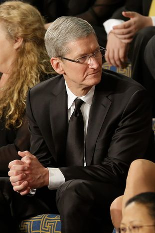 Apple CEO Tim Cook sits as a guest of first lady Michelle Obama prior to the start of President Barack Obama's State of the Union address during a joint session of Congress, Tuesday, Feb.12, 2013,  on Capitol Hill in Washington. (AP Photo/Pablo Martinez Monsivais)