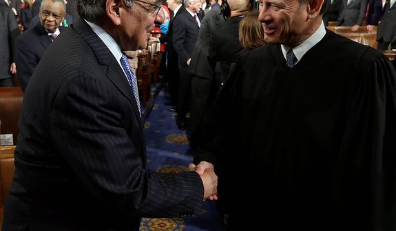 Outgoing Defense Secretary Leon Panetta, left, shakes hands with Chief Justice John Roberts before President Barack Obama's State of the Union address during a joint session of Congress on Capitol Hill in Washington, Tuesday Feb. 12, 2013. (AP Photo/Charles Dharapak Pool)