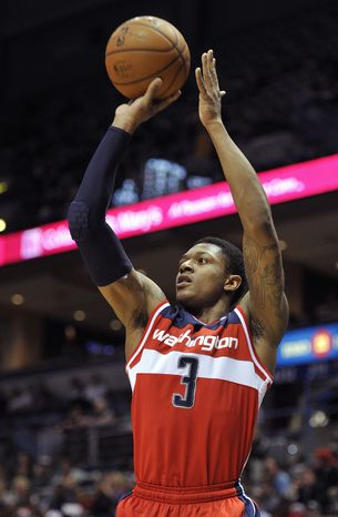 Washington Wizards' Bradley Beal (3) shoots a three point basket against the Milwaukee Bucks during the first half of an NBA basketball game Monday, Feb. 11, 2013, in Milwaukee. (AP Photo/Jim Prisching)