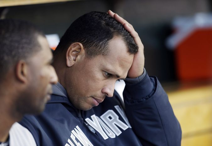 **FILE** In this Oct. 18, 2012, file photo, New York Yankees' Alex Rodriguez watches from the dugout during Game 4 of the American League championship series against the Detroit Tigers in Detroit. Yankees general manager Brian Cashman says it's possible that third baseman Alex Rodriguez could miss the entire season while coming off hip surgery. He made his remarks Friday on WFAN radio in New York. (AP Photo/Paul Sancya, File)