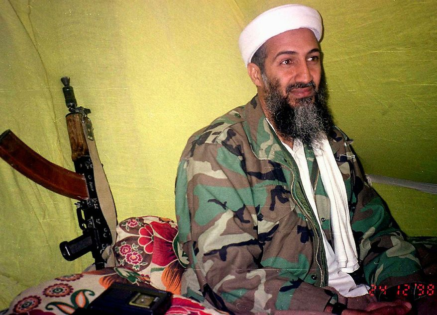 ** FILE ** In this Dec. 24, 1998, photo, Muslim militant and al Qaeda leader Osama Bin Laden speaks to a selected group of reporters in mountains of Helmand province in southern Afghanistan. (AP Photo/Rahimullah Yousafzai)