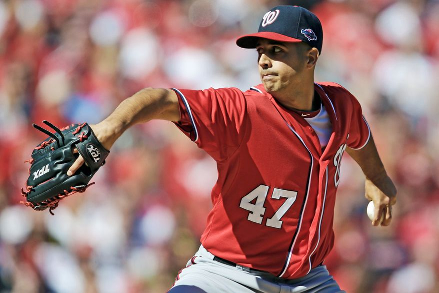 Nationals starting pitcher Gio Gonzalez throws during the first inning in Game 1 of the National League Division Series against the St. Louis Cardinals on Oct. 7. (Associated Press)