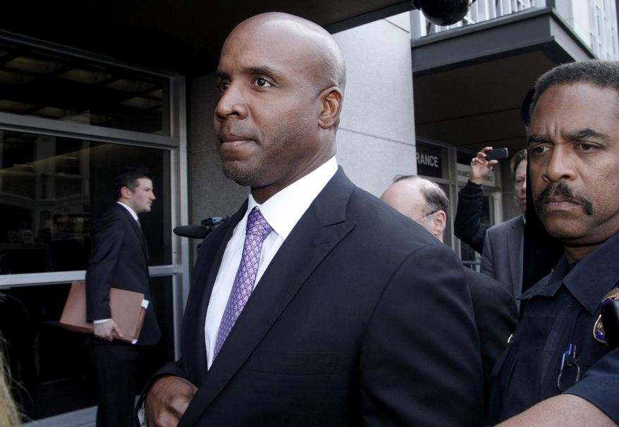 **FILE** In this Wednesday, April 13, 2011 file photo, former baseball player Barry Bonds leaves federal court in San Francisco, after being found guilty of one count of obstruction of justice. Bonds' appeal of his obstruction of justice conviction is scheduled to be heard by a three judge panel of the 9th U.S. Circuit Court of Appeals, Wednesday, Feb. 13, 2013. (AP Photo/George Nikitin, File)