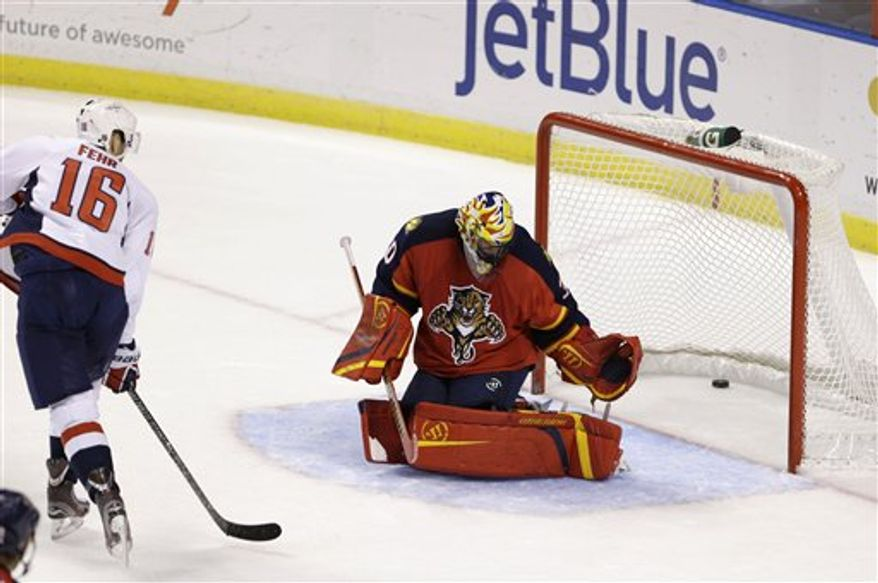Washington Capitals right wing Eric Fehr (16) scores a goal against Florida Panthers goalie Scott Clemmensen during the third period of an NHL hockey game, Tuesday, Feb. 12, 2013 in Sunrise, Fla. The Capitals defeated the Panthers 6-5 in overtime. (AP Photo/Wilfredo Lee)