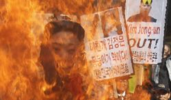South Korean protesters burn an effigy of North Korean leader Kim Jong-un during an anti-North Korea rally denouncing the North's nuclear test in Seoul, South Korea, Wednesday, Feb. 13, 2013. (AP Photo/Ahn Young-joon)
