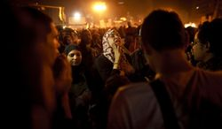 An Egyptian woman chants slogans in Tahrir Square in Cairo on Friday, Jan. 25, 2013, two years after the uprising that ousted President Hosni Mubarak. (AP Photo/Maya Alleruzzo)