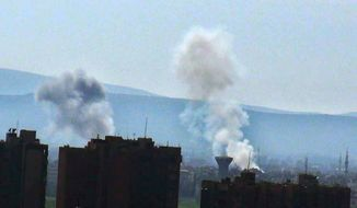 Smoke rises from heavy shelling in the Hajar Aswad neighborhood of Damascus, Syria, on Wednesday, Feb. 13, 2013, in this citizen journalism image provided by the Syrian Revolution and authenticated based on its contents and other AP reporting. (AP Photo/The Syrian Revolution)