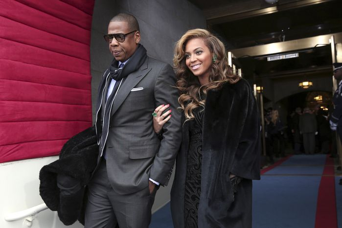 Recording artists Jay-Z and Beyonce arrive at the U.S. Capitol in Washington for President Obama's ceremonial swearing-in ceremony on Monday, Jan. 21, 2013, during the 57th Presidential Inauguration. (AP