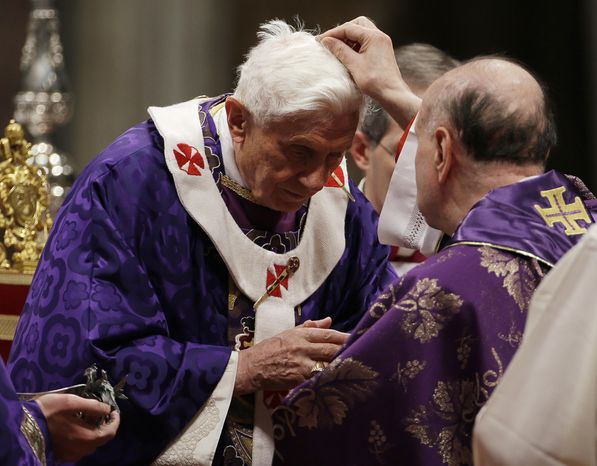 Cardinal Angelo Comastri puts ash on Pope Benedict XVI's head during the celebration of Ash Wednesday Mass in St. Peter's Basilica at the Vatican, Wednesday, Feb. 13, 2013. Ash Wednesday marks the beginning of Lent, a solemn period of 40 days of prayer and self-denial leading up to Easter. (AP Photo/Gregorio Borgia)