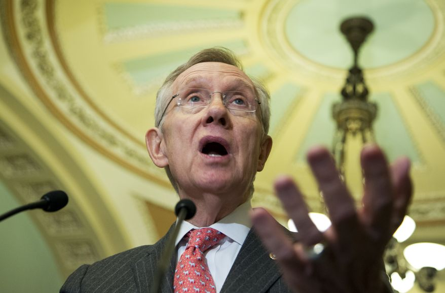 **FILE** Senate Majority Leader Sen. Harry Reid of Nevada speaks to reporters on Capitol Hill on Feb. 12, 2013, prior to President Obama's State of the Union address. (Associated Press)