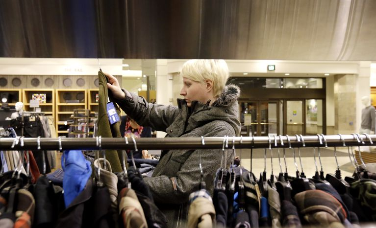 A customer shops at a Nordstrom store in Chicago on Thursday, Jan. 10, 2013. (AP Photo/Nam Y. Huh)