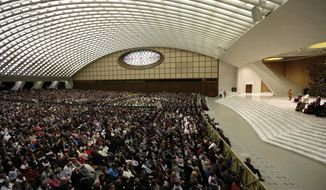 """Pope Benedict XVI leads his weekly general audience in the Paul VI Hall at the Vatican on Wednesday, Feb. 13, 2013. Looking tired but serene, the pontiff told thousands of faithful he was stepping down for """"the good of the church,"""" speaking in his first public appearance since dropping the bombshell announcement of his resignation.  (AP Photo/Alessandra Tarantino)"""