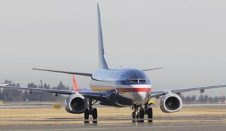 ** FILE ** In this Oct. 1, 2012 photo, an American Airlines airplane taxis for take off from Seattle-Tacoma International Airport in Seattle. (AP Photo/Ted S. Warren)