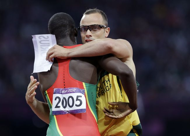 **FILE** South Africa's Oscar Pistorius embraces Grenada's Kirani James after the men's 400-meter semifinal during the athletics in the Olympic Stadium at the 2012 Summer Olympics, London, Sunday, Aug. 5, 2012. (AP Photo/Anja Niedringhaus)