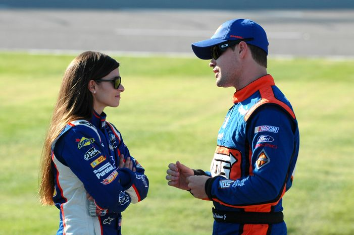 **FILE** In this Nov. 3, 2012, file photo, drivers Danica Patrick, left, talks with Ricky Stenhouse Jr., as they wait on pit road during qualifying for a NASCAR Nationwide series auto race at Texas Motor Speedway in Fort Worth, Texas. Patrick slid into her chair at NASCAR media day Thursday, Feb. 14, 2013 and promptly informed her audience she'd only answer racing-related que