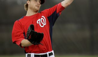 Washington Nationals pitcher Ross Detwiler throws during a spring training baseball workout Thursday, Feb. 14, 2013, in Viera, Fla. (AP Photo/David J. Phillip)