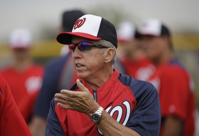Washington Nationals manager Davey Johnson talks with players during a spring training baseball workout Thursday, Feb. 14, 2013, in Viera, Fla. (AP Photo/David J. Phillip)