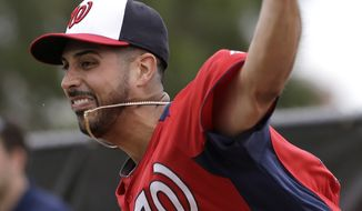 Washington Nationals pitcher Gio Gonzalez throws during a spring training baseball workout Thursday, Feb. 14, 2013, in Viera, Fla. (AP Photo/David J. Phillip)