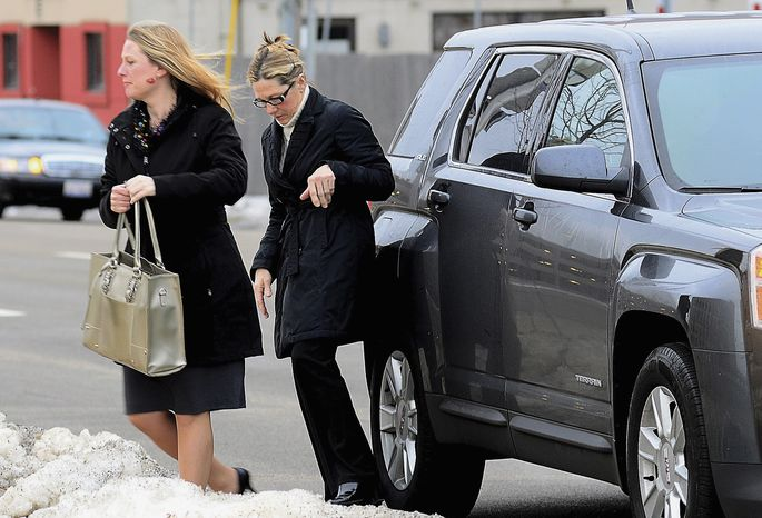 Rita Crundwell (right), the former comptroller of Dixon, Ill., who pleaded guilty in November 2012 to wire fraud, admitting she stole nearly $54 million from the city, arrives with her lawyer, Kristin Carpenter, at the federal courthouse in Rockford, Ill., for her sentencing on Thursday, Feb. 14, 2013. (AP Photo/Sauk Valley Media, Alex T. Paschal)