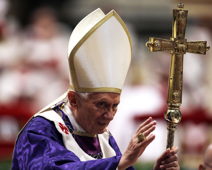 Pope Benedict XVI greets the faithful at the end of the Ash Wednesday Mass in St. Peter's Basilica at the Vatican on Wednesday, Feb. 13, 2013. (AP Photo/Gregorio Borgia)