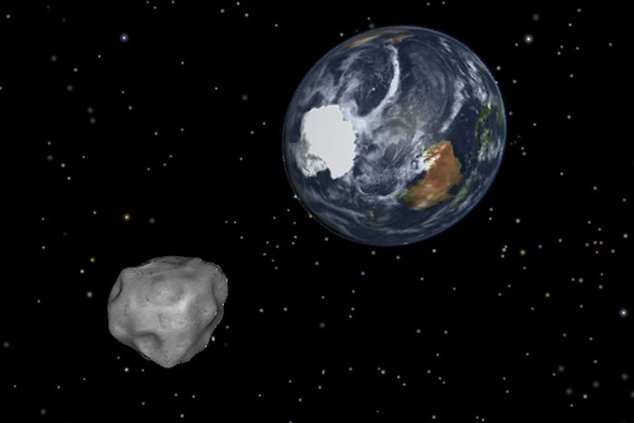 This image shows a simulation of asteroid 2012 DA14 approaching from the south as it passes through the Earth-moon system on Feb. 15, 2013. The 150-foot object passed within 17,000 miles of the Earth. (Associated Press/NASA/JPL-Caltech)