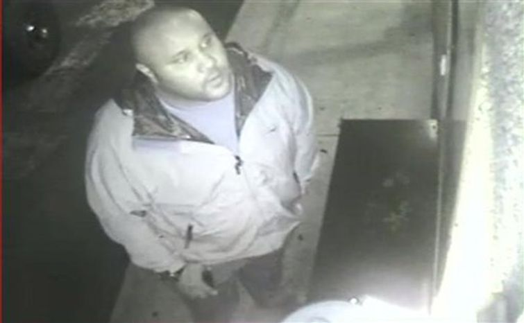 This image provided by the Irvine Police Department shows Christopher Dorner from Jan. 28, 2013, surveillance video at an Orange County, Calif., hotel. More than 100 officers, including SWAT teams, were driven in glass-enclosed snow machines and armored personnel carriers in Big Bear Lake to hunt for this former Los An