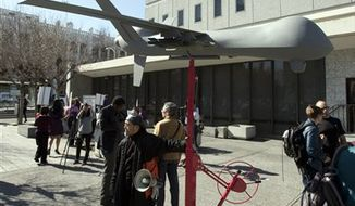 A model of a military-style drone stands outside the Alameda County Administration Building in Oakland, Calif., on Thursday, Feb. 14, 2013, before the start of a hearing on the Alameda County sheriff's plan to acquire a drone for aerial enforcement. (AP Photo/The Contra Costa Times, D. Ross Cameron)