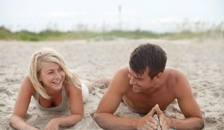 "Julianne Hough's character leaves Boston with police in pursuit and ends up in a South Carolina beach town where she bonds with Josh Duhamel's character in ""Safe Haven."" (Relativity Media via Associated Press)"