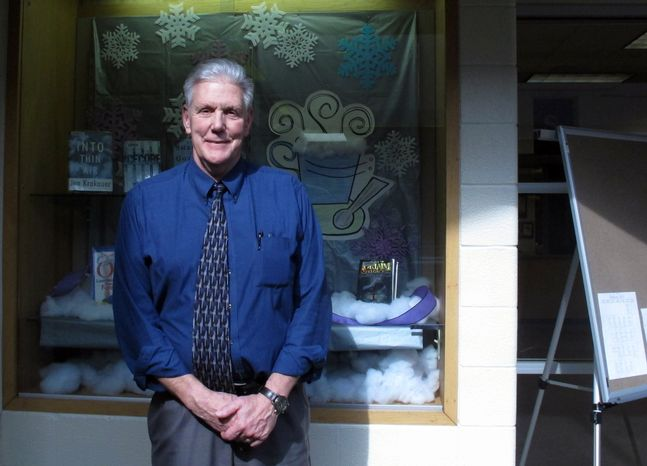 """** FILE ** In this Wednesday, Feb. 13, 2013, photo, Sullivan High School principal David Springer poses in the school in Sullivan, Ind. Students and staff at the high school are trying to distance themselves from the media frenzy over one local group's plea for a """"traditional"""" prom that would ban gay teens. (AP Photo/Pam Engel)"""