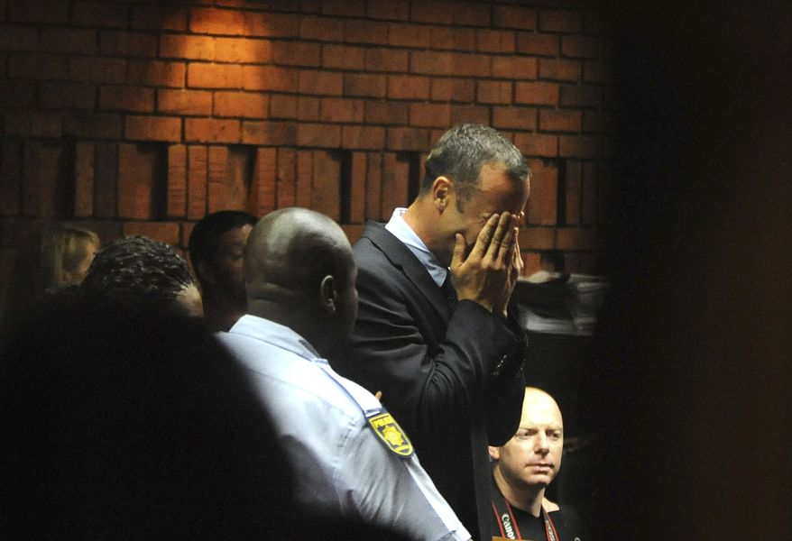 ** FILE ** Athlete Oscar Pistorius weeps in court in Pretoria, South Africa, on Friday, Feb. 15, 2013, at his bail hearing in the death of his girlfriend, Reeva Steenkamp. (AP Photo/Antione de Ras, Independent Newspapers Ltd. South Africa)