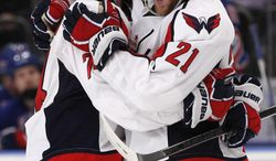 **FILE** Washington Capitals defenseman John Carlson (74) celebrates with center Brooks Laich (21) after scoring a goal against the New York Rangers in the third period of Game 5 of the NHL hockey Stanley Cup Eastern Conference semifinals, at Madison Square Garden in New York, Monday, May 7, 2012. (AP Photo/Kathy Willens)
