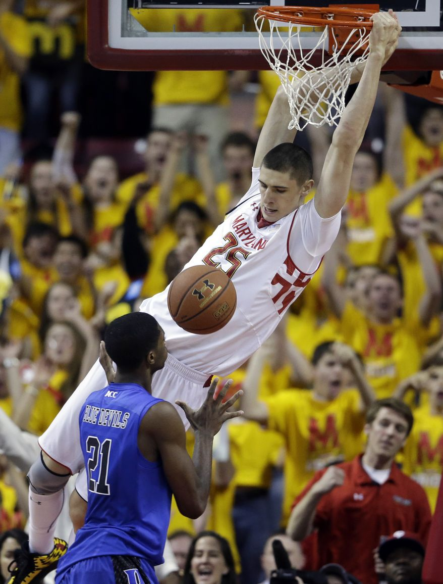 Maryland center Alex Len, top, of Ukraine, dunks on Duke forward Amile Jefferson in the first half of an NCAA college basketball game in College Park, Md., Saturday, Feb. 16, 2013. Maryland won 83-81. (AP Photo/Patrick Semansky)