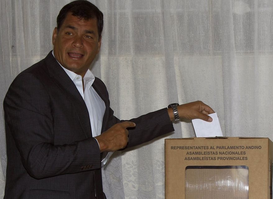 Ecuadorean President Rafael Correa casts his vote for National Assembly members in Quito, Ecuador, on Sunday, Feb. 17, 2013. Voters were electing the president, vice president and National Assembly members, with Mr. Correa highly favored to win a second re-election. His government has won broad backing from the lower classes as it leads Latin America in social spending. (AP Photo/Dolores Ochoa)
