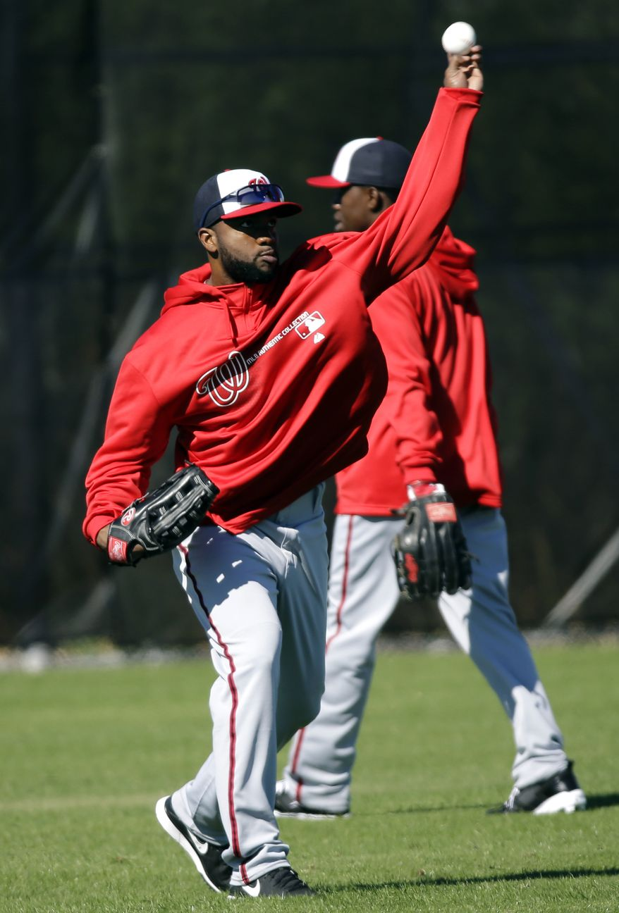 Washington Nationals outfielder Denard Span throws during a spring training baseball workout, Sunday, Feb. 17, 2013, in Viera, Fla. (AP Photo/David J. Phillip)