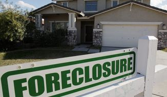 ** FILE ** A foreclosure sign sits outside a home for sale in Phoenix, Tuesday, Feb. 17, 2009. (AP Photo/Ross D. Franklin)