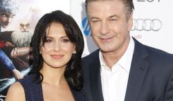 "** FILE ** This Nov. 4, 2012, file photo shows actor Alec Baldwin, right, and his wife Hilaria Thomas at the ""Rise Of The Guardians'"" special screening during the 2012 AFI FEST at Grauman's Chinese Theatre in the Hollywood section of Los Angeles. (Photo by Todd Williamson/Invision/AP, file)"