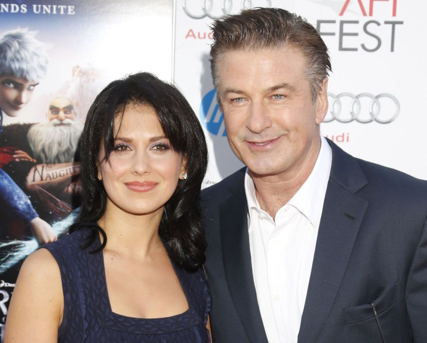 """** FILE ** This Nov. 4, 2012, file photo shows actor Alec Baldwin, right, and his wife Hilaria Thomas at the """"Rise Of The Guardians'"""" special screening during the 2012 AFI FEST at Grauman's Chinese Theatre in the Hollywood section of Los Angeles. (Photo by Todd Williamson/Invision/AP, file)"""