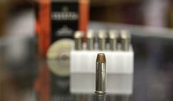 **FILE** A box of ammunition is seen on Oct. 17, 2012, on the counter of a gun shop in Tinley Park, Ill. (Associated Press)