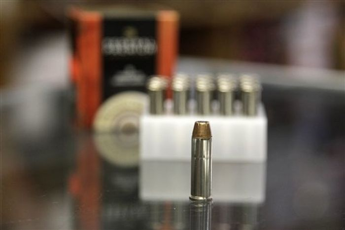 **FILE** A box of ammunition is seen on Oct. 17, 2012, on the counter of a gun shop in Tinley Park,