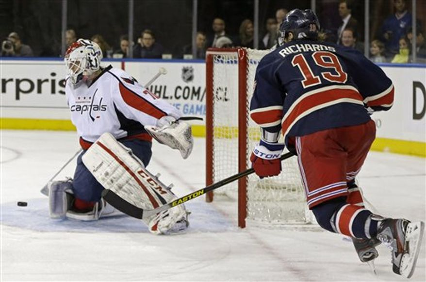 New York Rangers center Brad Richards (19) watches as Washington Capitals goalie Braden Holtby (70) makes a save in the second period of their NHL hockey game at Madison Square Garden in New York, Sunday, Feb. 17, 2013. (AP Photo/Kathy Willens)