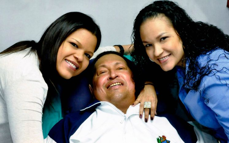 ** FILE ** In this photo released Friday, Feb. 15, 2013, by Miraflores Presidential Press Office, Venezuela's President Hugo Chavez, center, poses for a photo with his daughters, Maria Gabriela, left, and Rosa Virginia at an unknown location in Havana, Cuba, Thursday, Feb. 14, 2013. (AP Photo/Miraflores Presidential Press Office)