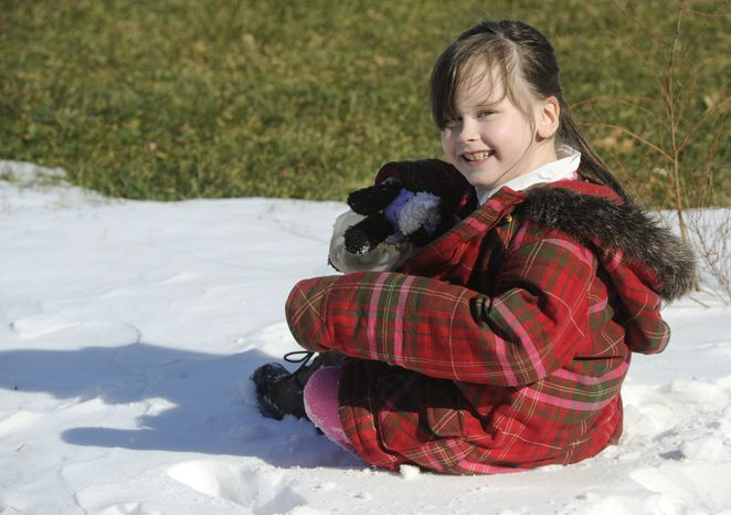 """In this Feb. 10, 2013, photo, Kelly Guarna's 5-year-old daughter Madison pose for a portrait in Mount Carmel, Pa. The kindergartener was suspended from school for making a """"terroristic threat"""" last month after her mother said she talked about shooting a Hello Kitty bubble gun. (AP Photo/Jimmy May)"""